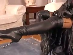 Hot Brunette Teasing In Leather And High Heel Boots