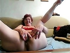 Horny Granny masturbating with big dildo