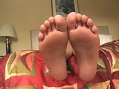 Hot Babe Wraps Her Toes Round A Lucky Fuckpole