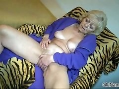 Dirty old woman goes crazy fingering her horny cunt by