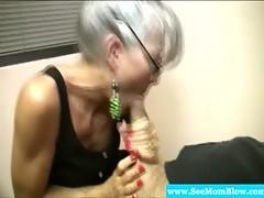 Sexy spex milf sucking on hard cock