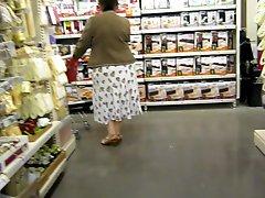 Mature upskirt with lacy slip