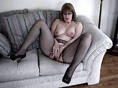 Mrs Commish fingers herself on the love seat
