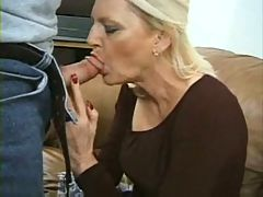 Mature blond slut takes on 2 guys