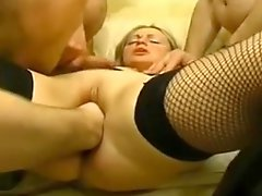Blonde slutty MILF fisted in a gangbang