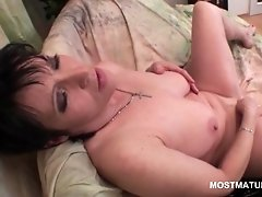 Busty Mature Brunette Stuffing Her Cunt With A Long Dil