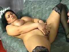 Dark haired German MILF in stockings is a lover of sex