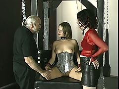 Young pain loving brunette is bound and whipped by older mistress in dungeon