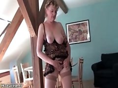 Horny busty mature woman puts her boobs out and starts