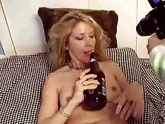 Mature puts a bottle in her fuck hole FM14