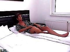Short haired mature lady masturbating
