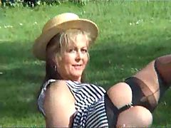 Mature blonde in stockings