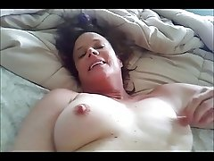 Masturbating MILF with some dick and a squirt