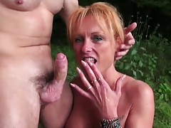 Redhead milf having sex in the woods