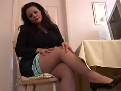 Busty mature brunette secretary in pantyhose