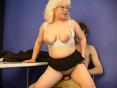 Guy Pupil & Plump Teacher Woman At The Lesson