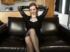 Redhead slut fondles her big juggs and beaver