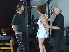 Hot redhead is restrained with red ropes and has her ass spanked hard