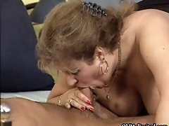 Nasty old whore goes crazy sucking on an hard cock and