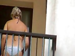Neighbor smoking on balcony