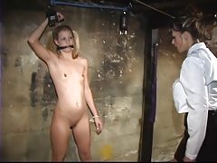 Young lesbian with tiny titties loves to play bdsm dungeon games with domme